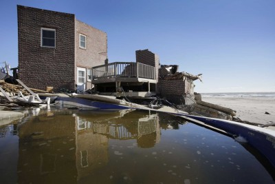 Homes, like this storm-damaged house on the beach in the Far Rockaways, would be purchased and torn down and the coastal land preserved under a plan by Gov. Andrew M. Cuomo. (Jan. 31, 2013)