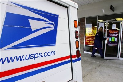 A U.S. Postal Service letter carrier picks up and delivers mail. (Dec. 6, 2011)