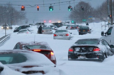 Snowbound vehicles remain stranded along Route 347 in Lake Grove. (Feb. 9, 2013) Photo Credit: Newsday/John Paraskevas
